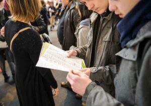 young men talking at careers fair