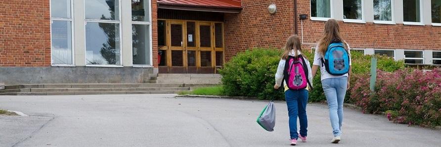 two-children-outside-school